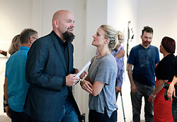 02 October 2014. Jonathan Ferrara Gallery, New Orleans, Louisiana. <br /> 'Guns In The Hands Of Artists' show opening at the Jonathan Ferrara Gallery. Jonathan Ferrara and his artist wife Sidone Villere. <br /> Photo; Charlie Varley/varleypix.com