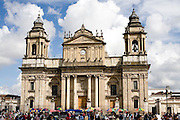 Sunday 12 November 2006<br /> Daily Life scenes from the Parque Central main Square in Guatemala City. The church is the Metropolitan Cathedral , the main Catholic Church building in Guatemala.