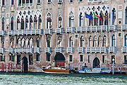 "Venice (Venezia) is the capital of Italy's Veneto region, named for the ancient Veneti people from the 10th century BC. The romantic ""City of Canals"" stretches across 117 small islands in the marshy Venetian Lagoon along the Adriatic Sea in northeast Italy, Europe. The Republic of Venice wielded major sea power during the Middle Ages, Crusades, and Renaissance. Riches from Venice's silk, grain, and spice trade in the 1200s to 1600s built elaborate architecture combining Gothic, Byzantine, and Arab styles. Venice and the Venetian Lagoon are honored on UNESCO's World Heritage List."