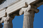 ATHENS, GREECE - APRIL 10 : A low angle view of Ionic columns of the Erechtheum, on April 10, 2007, in Athens, Greece. The Erechtheum was built on the Acropolis, between 421 and 405 BC, in the Ionic Order. The capitals of the columns are decorated with palmettes and a cable pattern between the volutes. (Photo by Manuel Cohen)