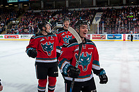 KELOWNA, CANADA - NOVEMBER 29: Braydyn Chizen #22, Gordie Ballhorn #4 and Liam Kindree #26 of the Kelowna Rockets skate to the bench to celebrate a goal against the Prince George Cougars on November 29, 2017 at Prospera Place in Kelowna, British Columbia, Canada.  (Photo by Marissa Baecker/Shoot the Breeze)  *** Local Caption ***