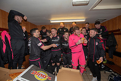 Arbroath's players cele with pizza after winning the league. Brechin City 1 v 1 Arbroath, Scottish Football League Division One played 13/4/2019 at Brechin City's home ground Glebe Park. Arbroath win promotion.