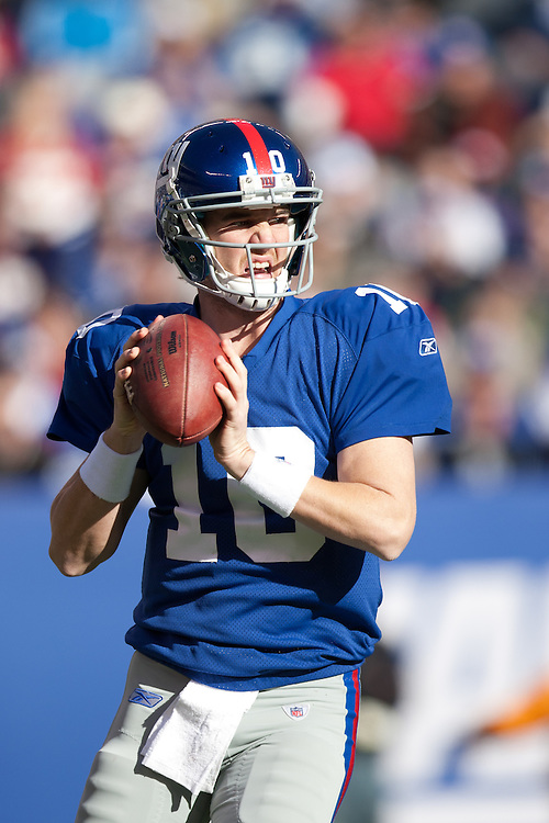 EAST RUTHERFORD, NJ - NOVEMBER 28: New York Giants quarterback Eli Manning #10 rolls out to pass against the Jacksonville Jaguars on November 28, 2010 at the New Meadowlands Stadium in East Rutherford, New Jersey.The Giants defeated the Jaguars 24 to 20. (Photo by Rob Tringali) *** Local Caption *** Eli Manning