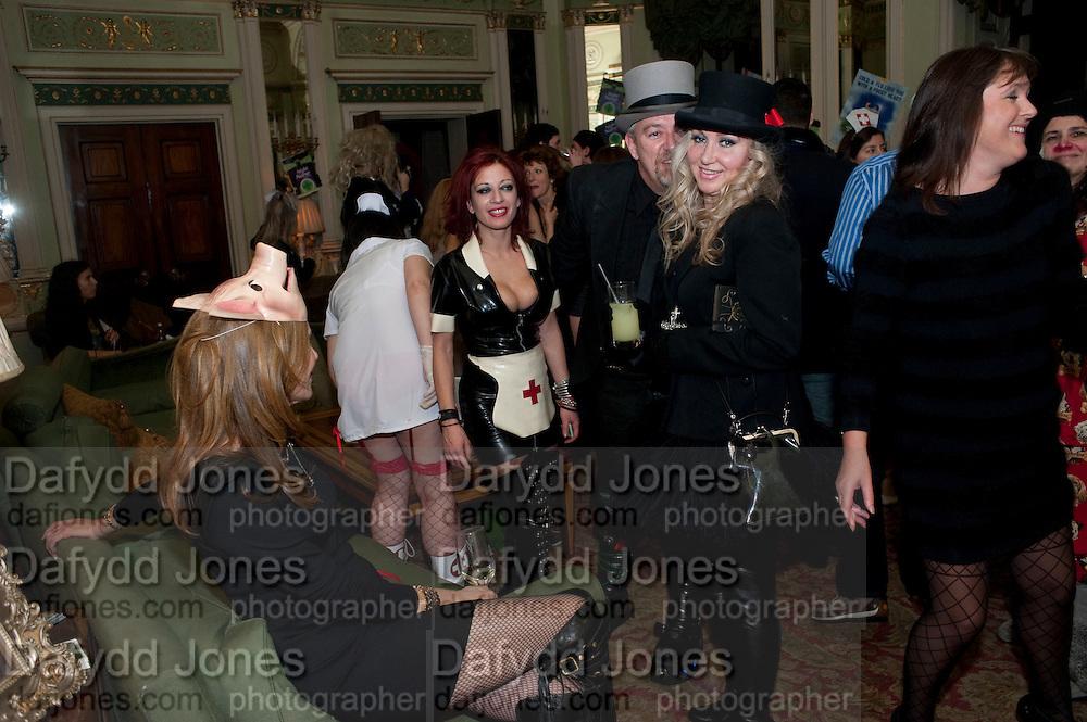 PAUL LEVY;RUBBERELLA,  Philip Sallon's mass paranoia swine flu birthday party. DRESS: DISEASE RELATED OR SWINE, Home House. Portman Sq. London. 13 November 2009. *** Local Caption *** -DO NOT ARCHIVE-© Copyright Photograph by Dafydd Jones. 248 Clapham Rd. London SW9 0PZ. Tel 0207 820 0771. www.dafjones.com.<br /> PAUL LEVY;RUBBERELLA,  Philip Sallon's mass paranoia swine flu birthday party. DRESS: DISEASE RELATED OR SWINE, Home House. Portman Sq. London. 13 November 2009.