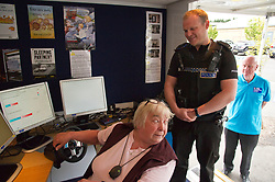 Pictured: Marie Duffy (69)  had a go on the simulator under the watchfull eye of PC Brain McGuff<br /> <br /> Destination Drive launch. The initiative aims to help older drivers stay safe on the road. Open invitation to first drop-in session where you can get a free assessment drive and try the current theory and hazard perception tests. <br /> <br /> Ger Harley | EEm 12 June 2018