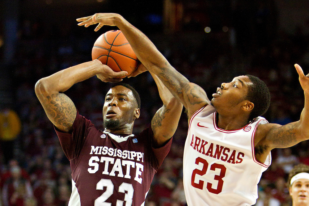 FAYETTEVILLE, AR - JANUARY 7:    Julysses Nobles #23 of the Arkansas Razorbacks tries to block the shot of Arnett Moultrie #23 of the Mississippi State Bulldogs at Bud Walton Arena on January 7, 2012 in Fayetteville, Arkansas.  (Photo by Wesley Hitt/Getty Images) *** Local Caption *** Julysses Nobles; Arnett Moultrie
