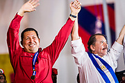 "10 JANUARY 2007 - MANAGUA, NICARAGUA: HUGO CHAVEZ, President of Venezuela, left, and DANIEL ORTEGA, President of Nicaragua, wave to the crowd during Ortega's inaugural speech in Managua.  Daniel Ortega, the leader of the Sandanista Front, was sworn in as the President of Nicaragua Wednesday. Ortega and the Sandanistas ruled Nicaragua from their victory of ""Tacho"" Somoza in 1979 until their defeat by Violetta Chamorro in the 1990 election.  Photo by Jack Kurtz"