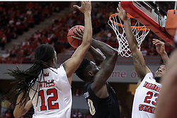20 March 2017:  Tank Efianayi shoots while doubled by Tony Wills(12) and Deontae Hawkins(23) during a College NIT (National Invitational Tournament) 2nd round mens basketball game between the UCF (University of Central Florida) Knights and Illinois State Redbirds in  Redbird Arena, Normal IL