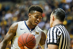 Dec 5, 2017; Morgantown, WV, USA; West Virginia Mountaineers guard Daxter Miles Jr. (4) talks to an official during the first half against the Virginia Cavaliers at WVU Coliseum. Mandatory Credit: Ben Queen-USA TODAY Sports