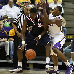 14 February 2009 Malcolm White (21) of Ole Miss is defended by LSU forward Tasmin Mitchell (1) during a NCAA basketball game between SEC rivals the Ole Miss Rebels and the LSU Tigers at the Pete Maravich Assembly Center in Baton Rouge, LA.