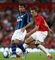Photo: Paul Thomas.<br /> Manchester United v Inter Milan. Pre Season Friendly. 01/08/2007.<br /> <br /> Michael Carrick (R) of Utd puts pressure on Dejan Stankovic.