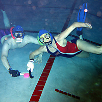 Christopher Lewis and his wife Nicole Van-Nood work on their underwater hockey skills at the University of Texas Recreation center off Knight Road.