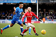 Charlton midfielder Jonathan Williams (21) clears up this attack from Peterborough Utd defender Rhys Bennett (16) during the EFL Sky Bet League 1 match between Peterborough United and Charlton Athletic at London Road, Peterborough, England on 26 January 2019.