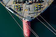 Seamen checks the lines on a cargo ship that is discharging cargo at the Port of Long Beach California