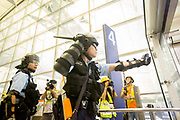 CHINA, Hong Kong: 13 August 2019 <br /> A member of the riot police aims pepper spray at protesters during clashes at Hong Kong International Airport on the evening of 13th August 2019. Thousands of demonstrators brought Hong Kong's airport to a standstill for a second day in a row in protest of the extradition bill as well as the police violence and brutality. Demonstrators have taken to the streets of Hong Kong in protest of a controversial extradition bill since 9th of June which has resulted in several violent clashes.<br /> Rick Findler / Story Picture Agency