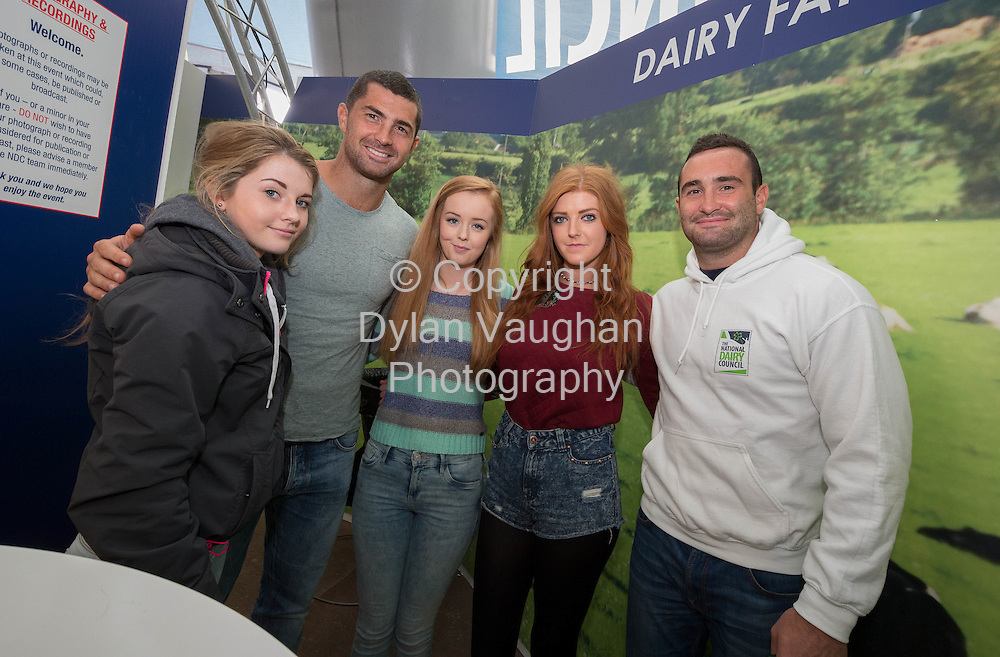 Repro Free no charge for Repro<br /> <br /> 23-9-14<br /> Rob and Dave Kearney to Join NDC at Ploughing &amp; Judge &lsquo;Welly Line Out&rsquo; NDCDome at ploughing: Block 3/ Row 21/ Stand 306<br />  <br /> Rugby professionals Rob and Dave Kearney joined the National Dairy Council on the first day of the National Ploughing Championships at Ratheniska, Co. Laois (Tuesday 23rd September, 2014) where they took part in on-stage discussions in the NDC Dome, met members of the public and judged a colourful &lsquo;Welly Line Out&rsquo;.<br />  <br /> Rob and Dave Kearney are ambassadors to the NDC, helping to highlight the importance of starting good habits young in relation to diet and exercise; showcasing the natural goodness of Ireland&rsquo;s pasture based dairy farming and promoting the positive role that milk may play in a number of aspects of sports nutrition, based on emerging scientific research in this area.    They feature in an NDC advertisement campaign (It All Starts Here) filmed on the farm in the Cooley Peninsula where Rob and Dave grew up.<br />  <br /> Pictured are Rob and Dave Kearney with Shannon Kavanagh (16), Emma Fitzgerald (18) and Katie Byrne (18) from Carnew Co. Wicklow.<br /> Picture Dylan Vaughan
