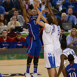 Apr 2, 2012; New Orleans, LA, USA; Kansas Jayhawks forward Thomas Robinson (0) shoots as Kentucky Wildcats forward Anthony Davis (23) and forward Terrence Jones (3) defend during the second half in the finals of the 2012 NCAA men's basketball Final Four at the Mercedes-Benz Superdome. Mandatory Credit: Derick E. Hingle-US PRESSWIRE