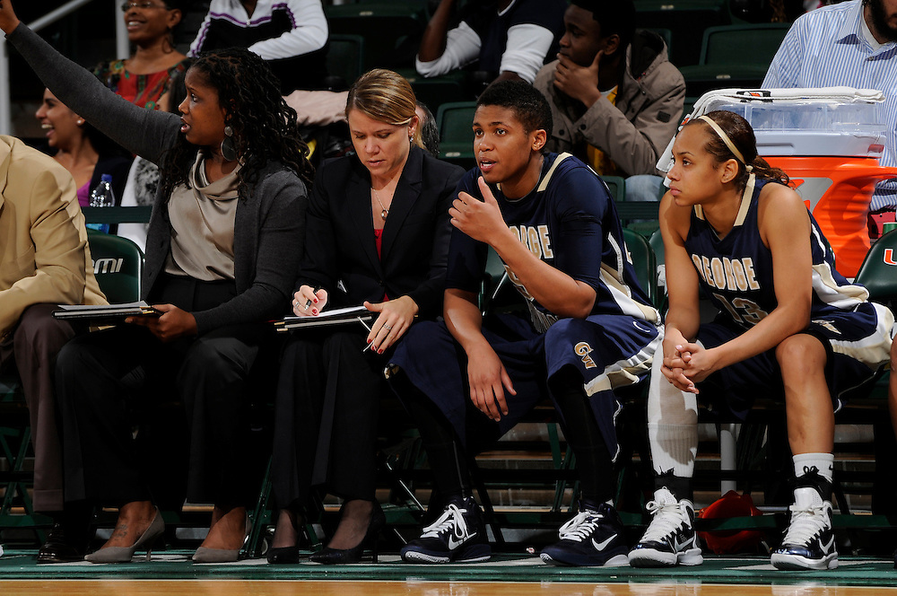 December 28, 2010: Kye Allums (50) of the George Washington Colonials sits on the bench next to   Kristeena Alexander (right) and Katie Rokus (middle) during the NCAA basketball game between GWU and the Miami Hurricanes. The 'Canes defeated the Colonials 83-62.