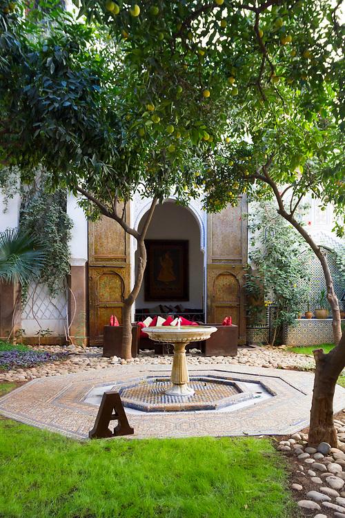 FEZ, MOROCCO - 31st OCTOBER 2013 - Riad Laaroussa traditional riad garden courtyard space, Old Fez Medina, Middle Atlas Mountains, Morocco.