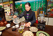 Tea merchant Lin Guang Xia serving fine Chinese green tea in headquarters of her tea shop chain. Zibo, Shandong Province, China