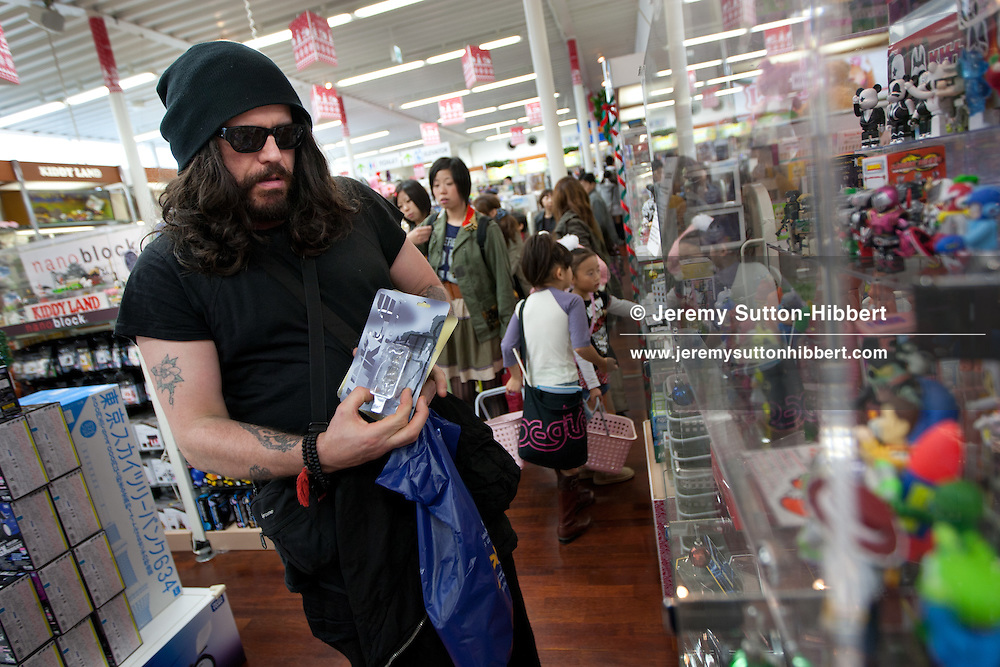 Ian Astbury, lead singer with The Cult, shopping in 'KiddyLand' shop for presents for his family, in the fashionable Harajuku district of Tokyo, Japan, Sunday 28th November 2010. Ian Astbury was in Tokyo to play as part of the band 'BXI'- a musical collaboration between himself and Japanese band 'Boris'. 'BXI' played at Club WWW, in Shibuya, Tokyo.