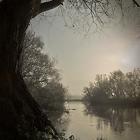 The river Waveney at Beccles, Suffolk, England. Early morning with calm water in winter.