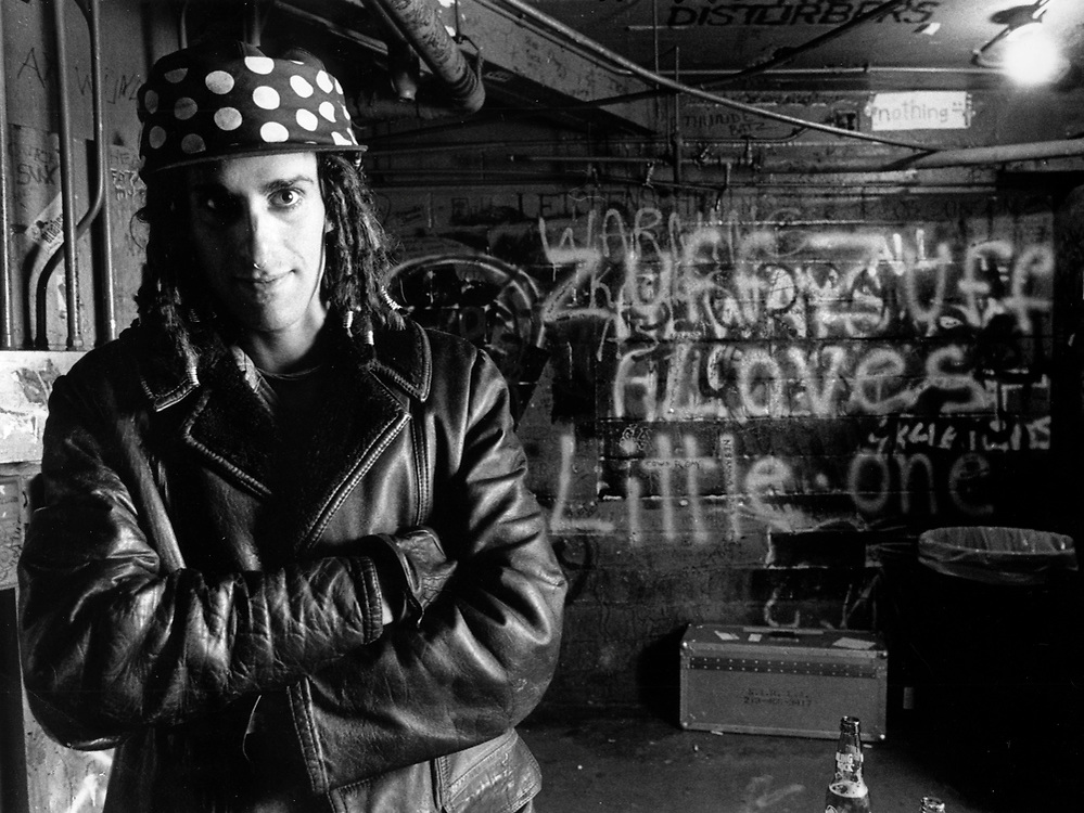 Jane's Addiction lead singer Perry Farrell poses for a picture after a night onstage at the night club First Avenue in Minneapolis, Minn., on January 1, 1989. Farrell later organized an alternative music festival, Lollapalooza, and started the group Porno for Pyros. (Photo by Geoff Hansen)
