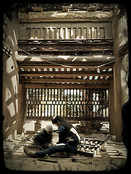 Two workers renovate an old interior, Hanoi, Vietnam, Southeast Asia