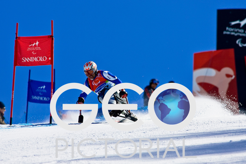 SESTRIERE COLLE, ITALY - MARCH 17th : Vindicio Vescovi of Italy in the Mens Alpine Skiing Giant Slalom Sitting competition on Day 7 of the 2006 Turin Winter Paralympic Games on March 17th, 2006 in Sestriere Borgata, Italy.