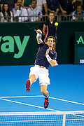 Andy Murray of Great Britain hits an overhead smash during the 2016 Davis Cup Semi Final between Great Britain and Argentina at the Emirates Arena, Glasgow, United Kingdom on 17 September 2016. Photo by Craig Doyle.