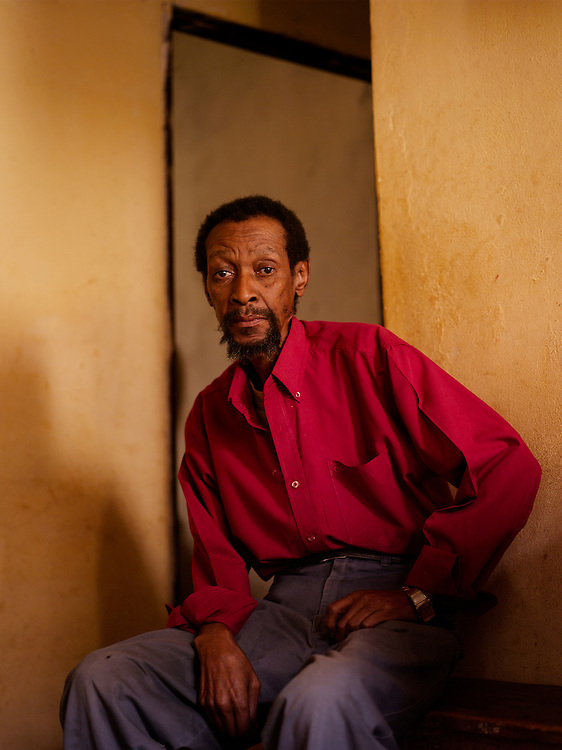 """Temba Palmer(b. 1948) went into exle in 1976 and went to the USSR where was trained in intelligence. He would  interrogate and investigate new arrivals to the MK camps abroad to determine if they were spies trying to infiltrate the structure.  He is now unemployed and lives in a small house.  """"If you are like myself, uneducated, you don't get  a job. Jobs are only for those people that went to school. That's the trouble."""".."""