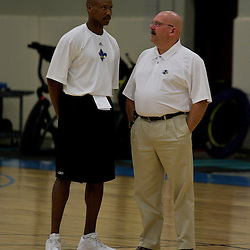 08 June 2009: Hornets head coach Byron Scott (L) talks with general manager Jeff Bower during a pre NBA draft workout for the New Orleans Hornets at the Alario Center in Westwego, Louisiana.