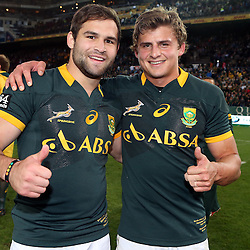 CAPE TOWN, SOUTH AFRICA - SEPTEMBER 27: Cobus Reinach with Pat Lambie of South Africa during The Castle Rugby Championship match between South Africa and Australia at DHL Newlands on September 27, 2014 in Cape Town, South Africa. (Photo by Steve Haag)