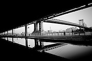 Reflection of the Manhattan bridge in a puddle down the expressway in South Manhattan, nEW yORK
