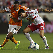 Tim Cahill, (right), New York Red Bulls, is challenged by Ricardo Clark, Houston Dynamo, during the New York Red Bulls V Houston Dynamo, Major League Soccer second leg of the Eastern Conference Semifinals match at Red Bull Arena, Harrison, New Jersey. USA. 6th November 2013. Photo Tim Clayton