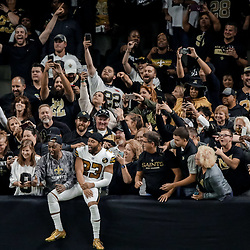 Nov 18, 2018; New Orleans, LA, USA; New Orleans Saints cornerback Marshon Lattimore (23) jumps into the stands to celebrate with fans after a Philadelphia Eagles turnover during the fourth quarter at the Mercedes-Benz Superdome. Mandatory Credit: Derick E. Hingle-USA TODAY Sports
