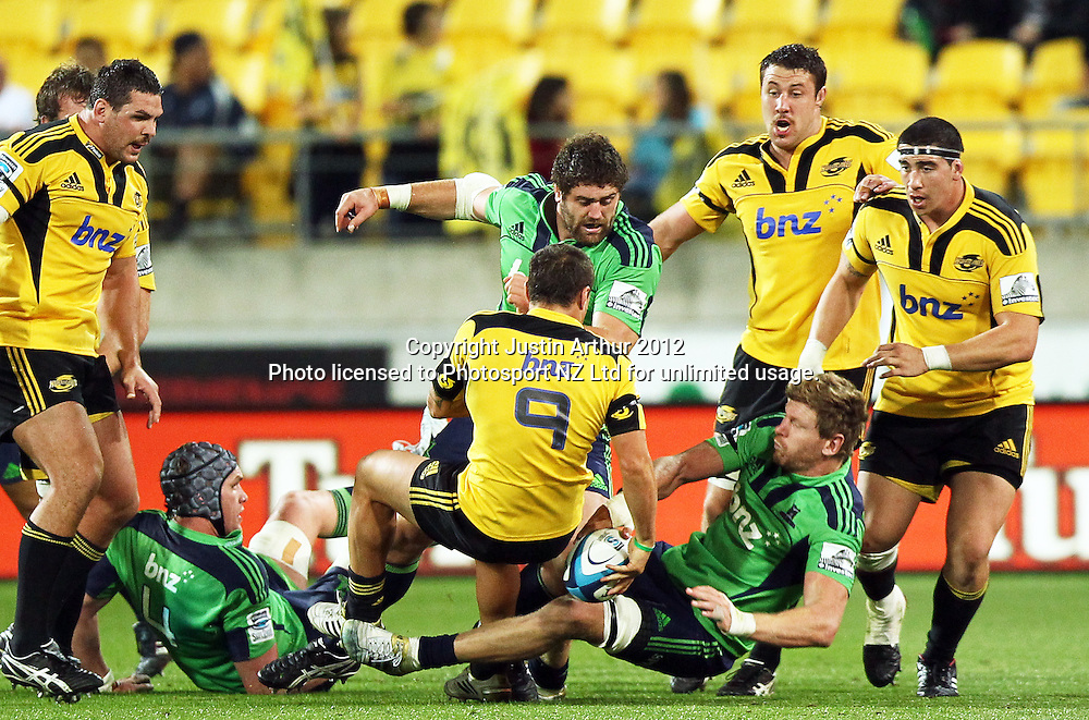 Highlanders' Jamie Mackintosh shoulder charges Hurricanes' TJ Perenara  during the 2012 Super Rugby season, Hurricanes v Highlanders at Westpac Stadium, Wellington, New Zealand on Saturday 17 March 2012. Photo: Justin Arthur / Photosport.co.nz