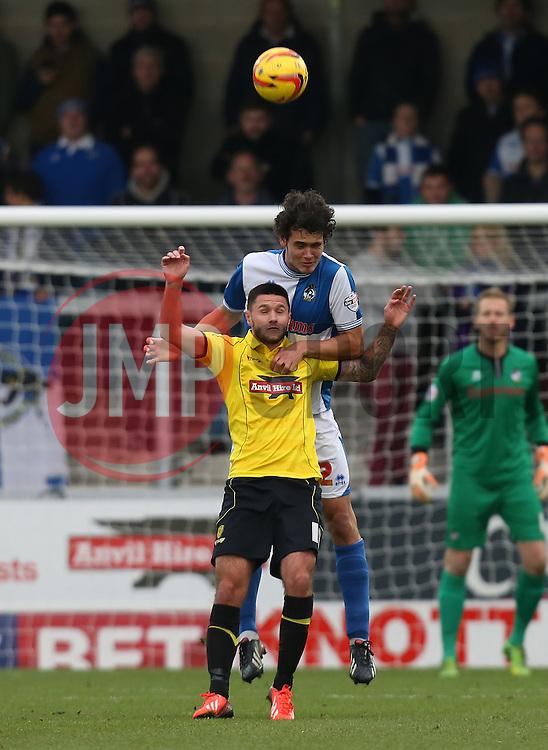 Bristol Rovers' Will Packwood wins a header against Burton Albion's Dominic Knowles- Photo mandatory by-line: Matt Bunn/JMP - Tel: Mobile: 07966 386802 23/11/2013 - SPORT - Football - Burton - Pirelli Stadium - Burton Albion v Bristol Rovers - Sky Bet League Two
