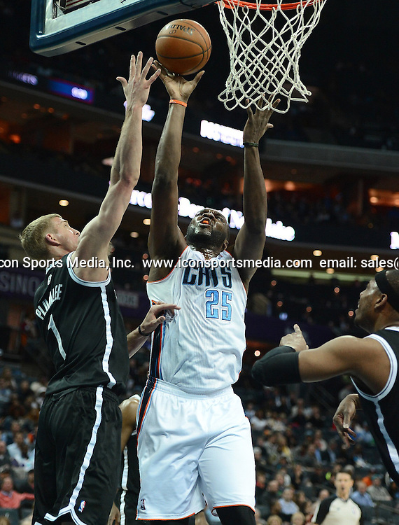 March 26, 2014 - Charlotte, NC, USA - The Charlotte Bobcats' Al Jefferson (25) lays a shot off the glass as the Brooklyn Nets' Mason Plumlee, left, defends in the first half on Wednesday, March 26, 2014, at Time Warner Cable Arena in Charlotte, N,C. The Bobcats won in overtime, 116-111