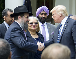 May 4, 2017 - Washington, District of Columbia, United States of America - United States President Donald J. Trump shakes hands with Rabbi Levi Shemtov, Executive Vice President of American Friends of Lubavitch (Chabad) board member of the Rabbinical Council of Greater Washington, Vaad Harabonim after signing a Proclamation designating May 4, 2017 as a National Day of Prayer and an Executive Order ''Promoting Free Speech and Religious Liberty'' in the Rose Garden of the White House in Washington, DC on Thursday, May 4, 2017..Credit: Ron Sachs / CNP (Credit Image: © Ron Sachs/CNP via ZUMA Wire)