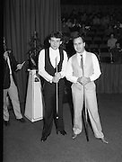 The Benson and Hedges .Irish Masters Snooker..1984..28.03.1984..03.28.1984..28th March 1984..The championship was held at Goffs,Co Kildare. All the top names in snooker took part..Steve Davis,Jimmy White,Eddie Charlton,.Tony Knowles,Dennis Taylor,Tony Meo,.Alex Higgins,Ray Reardon,.Cliff Thorburn,Terry Griffiths,.Bill Werbeniuk and Eugene Hughes..The eventual winner was Steve Davis who beat Terry Griffiths 9 -1 in the final.Photo of Jimmy White and Tony Meo as they pose for pre-game pictures.