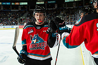 KELOWNA, BC - SEPTEMBER 28:  Jake Lee #21 of the Kelowna Rockets fist bumps the bench to celebrate a goal against the Everett Silvertips at Prospera Place on September 28, 2019 in Kelowna, Canada. (Photo by Marissa Baecker/Shoot the Breeze)
