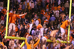 University of Virginia students celebrate on the goal posts on October 15, 2006 after the Cavaliers upset #4 Florida State 26-21 at Scott Stadium in Charlottesville, VA.<br />