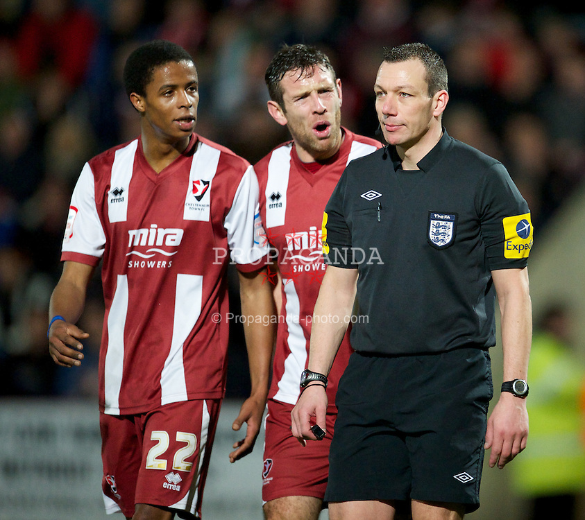 CHELTENHAM, ENGLAND - Monday, January 7, 2013: Cheltenham Town's Sido Jombati and captain Alan Bennett argue with referee Kevin Friend after he awards a penult to Everton during the FA Cup 3rd Round match at Whaddon Road. (Pic by David Rawcliffe/Propaganda)