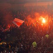 NLD/Amsterdam/20051122 - Voetbal, Champions League, Ajax - Sparta Praag, Ajax fans met vuurwerk en vlaggen
