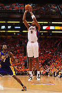 May 29, 2010; Phoenix, AZ, USA; Phoenix Suns center Channing Frye (8) puts up a shot during the second quarter in game six of the western conference finals in the 2010 NBA Playoffs at US Airways Center.  Mandatory Credit: Jennifer Stewart-US PRESSWIRE