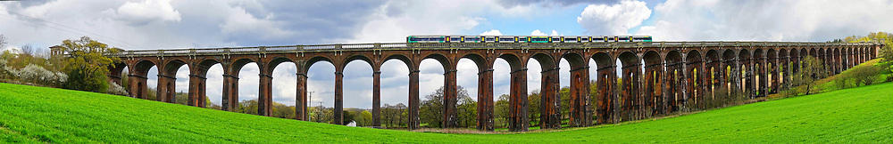 A panorama of the Ouse Valley Viaduct (also called Balcombe Viaduct) with a train. The viaduct was built in 1841, on the London to Brighton Railway Line in West Sussex,, England and 1,475 feet (450 m) long.