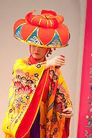 A woman dancer in traditional Okinawan (Ryukyu) kimono performs on stage at Ryukyu Mura on the main island of Okinawa.