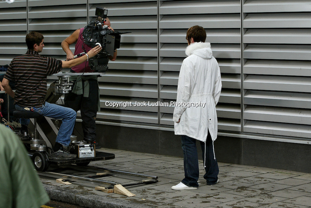 liam gallagher on set of heathen chemestry Oasis video in city of london 9 / 07 /2002.https://www.youtube.com/watch?feature=player_embedded&v=m5Sin7CN8fk