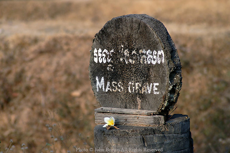 A marker signifies the final resting place of more than 8000 victims of the Pol Pot regime at the Killing Fields in Phnom Penh, Cambodia.